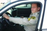 Nick Guskos of the LAHC sheriff's office sits in his patrol car Photo by Gabriel Islas